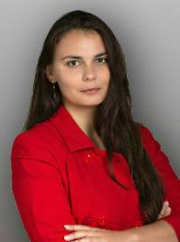 Ксения Комал, автор детективов